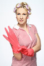 Housewife hands with gloves isolated on white Stock Images