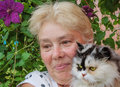 Housewife and her pet cat Royalty Free Stock Photo