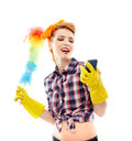 Housewife holding a duster and looking at a mobile phone studio shot of sexy isolated over white background Stock Photos