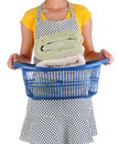 Housewife holding a laundry basket of towels closeup full freshly laundered woman is unrecognizable Royalty Free Stock Photography
