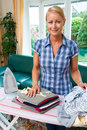 Housewife with iron Stock Photography