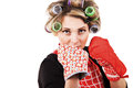 Housewife with kitchen gloves in boxing pose Royalty Free Stock Photo