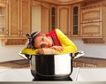 Housewife on the kitchen sad Royalty Free Stock Photo