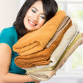 Housewife smell fresh laundry woman doing a housework holding good Stock Image