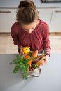 Housewife sort purchases after shopping Royalty Free Stock Photo