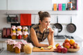 Housewife standing near jars with fruits jam Royalty Free Stock Photo