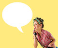 Housewife talking on the phone yellow background Stock Photos