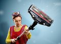Housewife with vacuum cleaner isolated on blue Stock Photo