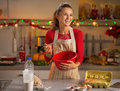 Housewife whisking dough in kitchen happy young christmas decorated Stock Photo