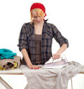 Housework - woman ironing clothes Royalty Free Stock Image