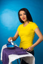 Houseworks, woman with pile of clothes for ironing Royalty Free Stock Photo