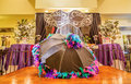 Housing clubhouse with mardi gras decor picture of a decorated a theme including decorative umbrellas on table tops focus on Stock Photo