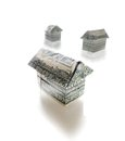 Housing market paper origami homes made out of dollar bills Stock Photography