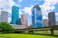 Houston texas skyline modern skyscapers and blue sky with view from park lawn Stock Photo