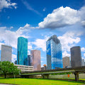 Houston texas skyline modern skyscapers and blue sky with view from park lawn Stock Image