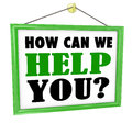 How can we help you hanging store sign helpful service the words on a offering customer and assistance Stock Photo