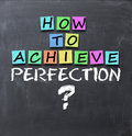 How to achieve perfection question on blackboard with adhesive notes Royalty Free Stock Photo