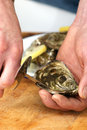 How to open one raw oyster Stock Photo