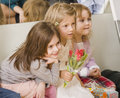 Hree little girls at birthday party having fun close up Royalty Free Stock Photo