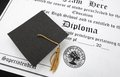 Hs diploma a mini graduation cap on a high school Royalty Free Stock Photos