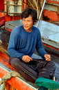 Hua Hin, Thailand: Fisherman Mending Nets Stock Images