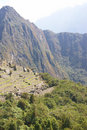 Huayna Picchu mountain overlooking  Inca ruins Stock Photos