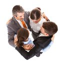Huddle of businesspeople high angle view embracing each other Royalty Free Stock Images