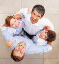 Huddle: Top view of coworkers standing together Royalty Free Stock Photography