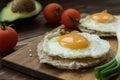 Huevos rancheros tostadas with avocado salsa Royalty Free Stock Photo