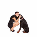 Hug woman hugging her dog studio shot Royalty Free Stock Photography