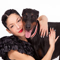 Hug woman hugging her dog studio shot Royalty Free Stock Images