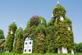 Huge beautiful amazing castle covered with green plants and colourful flowers Royalty Free Stock Photo