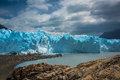 A huge blue glacier near the bay. Shevelev. Royalty Free Stock Photo
