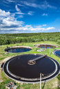 Huge circular settlers of sewage treatment plant under blue sky Royalty Free Stock Photos