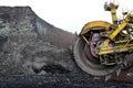 Huge coal excavator mining wheel in brown mine detail of Stock Images