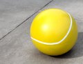 Huge concrete tennis ball super size larger than life Stock Image
