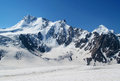 Huge glacier, snow and high rocky peaks of Caucasian mountains Royalty Free Stock Photo
