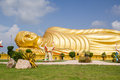 Huge golden sleeping Buddha with blue sky