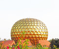 Huge golden spherical ball auroville tamil nadu india Royalty Free Stock Photo