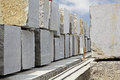Huge granite blocks extracted from quarry stacked in a stone processing factory for cutting and polishing into flooring slabs used Stock Photo