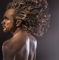 Huge hair wild man tribal concept traditions body covered wi with mud cool Stock Images