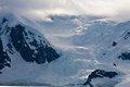 Huge ice glacier in antarctica with clouds Royalty Free Stock Images
