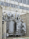 Huge industrial high voltage substation power transformer on rails at plant Stock Photos