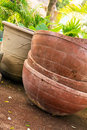 Huge mexican brownish plant pots in a garden somewhere in mexico Stock Photo