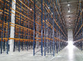Huge modern empty storehouse with metallic constructions Royalty Free Stock Photography