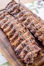 Huge pork ribs marinated in wine and barbecued Stock Photos