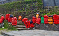 Huge red backpacks for mountain expedition on stairs. Porter Mountaineering equipment. Royalty Free Stock Photo