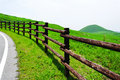 Huge road fence along volcano mountain Stock Photos