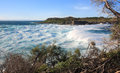 Huge surf and turbulent seas at jervis bay strong gusty winds whipped up rough view to bowen island Stock Photo