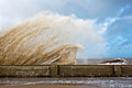 Huge waves crashing onto promenade Stock Photos